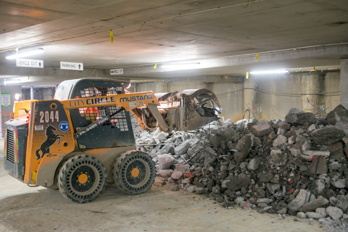 A 2044 Skid Steer being used to move debris from demolition works inside the car park at City Square.