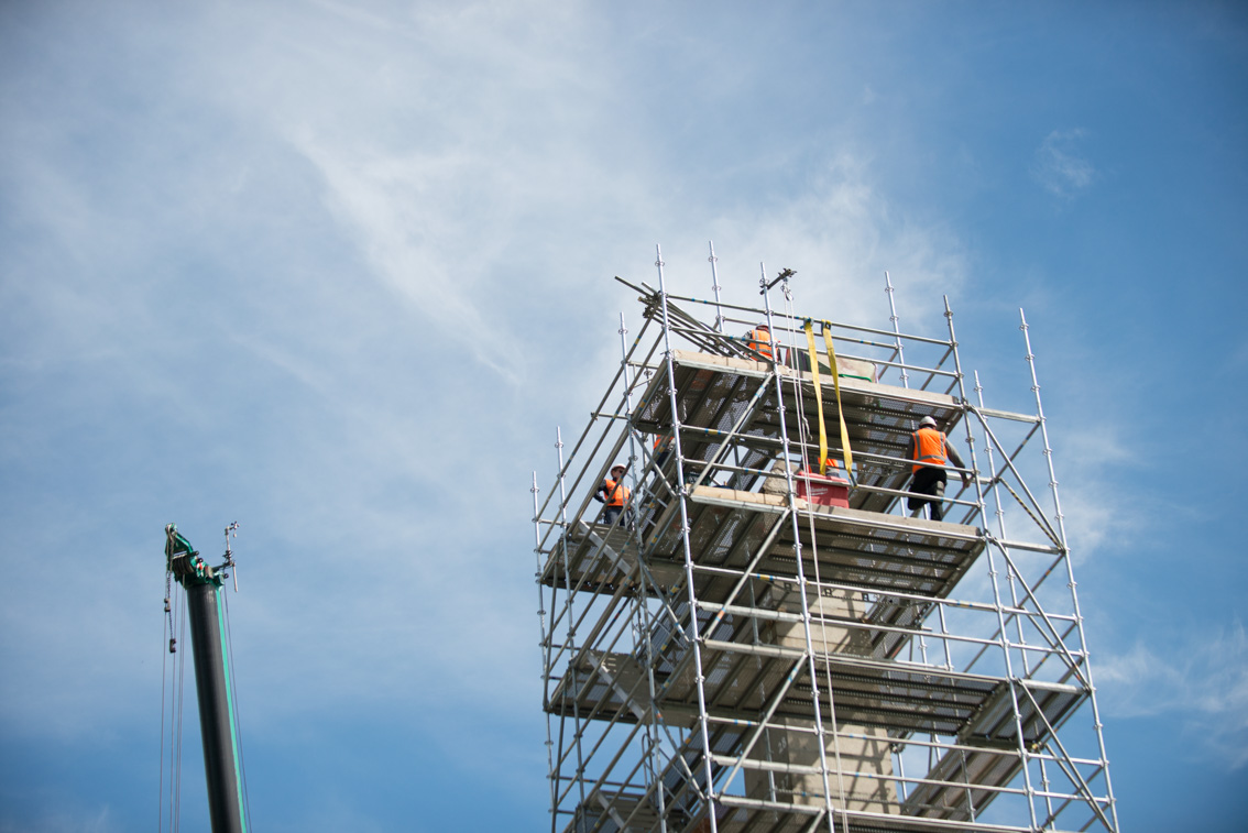 Workers on the scaffolding of the South African Soldiers Memorial during removal works.