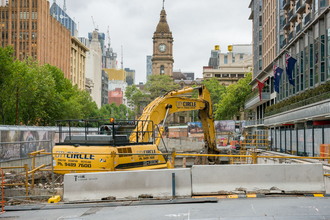 SH 330 excavator in City Square during car park demolition works, taken from Flinders Lane.