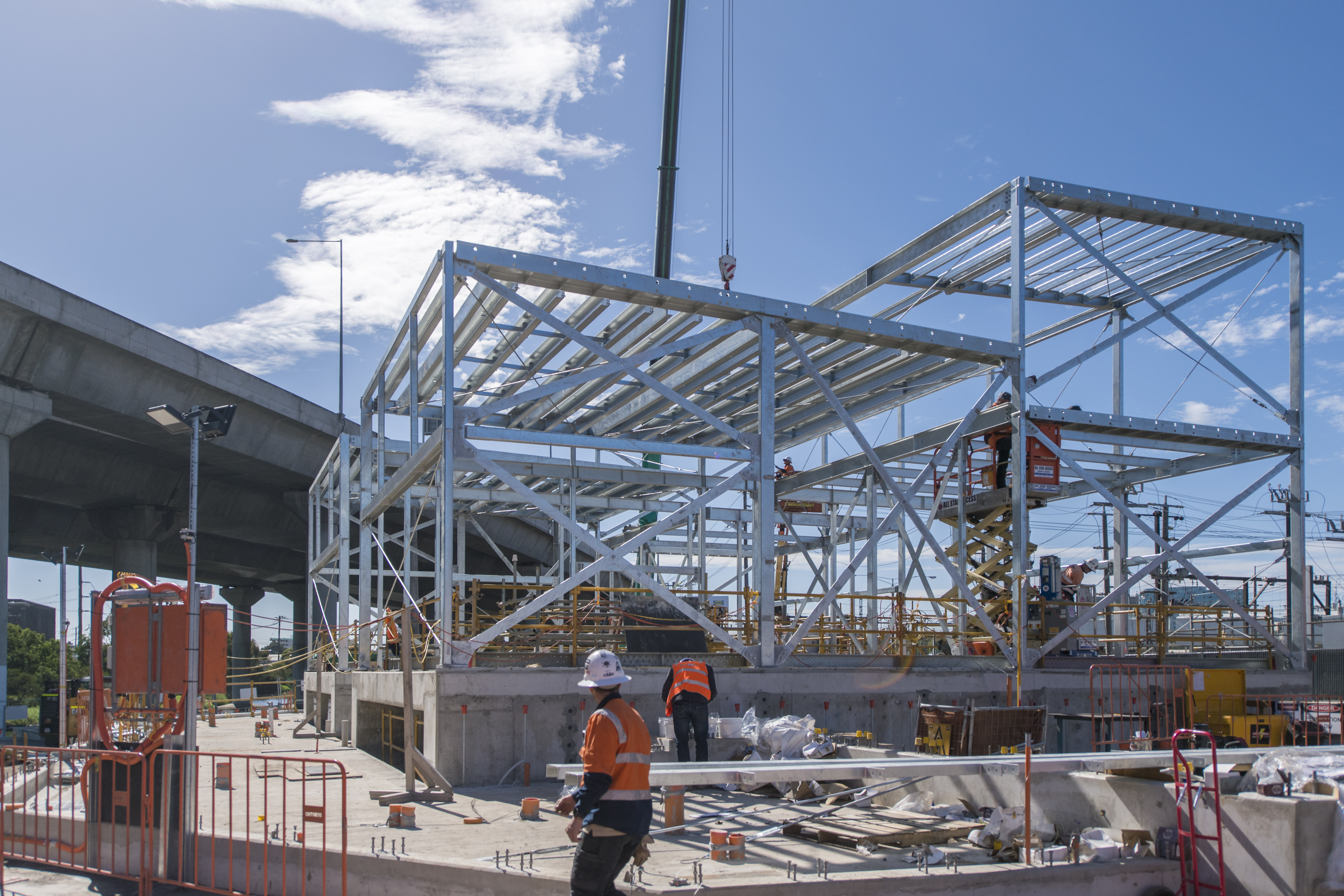 Workers building the framework of the North Melbourne electrical substation