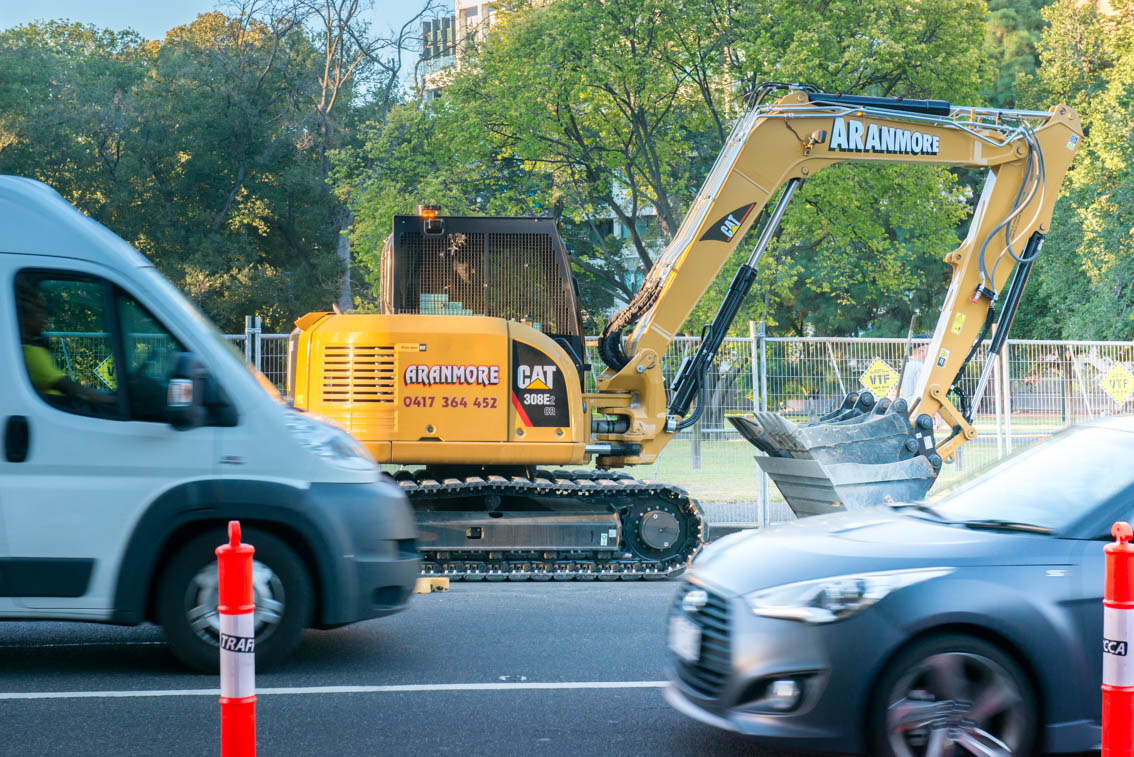 An Excavator in a service lane on St Kilda Road.