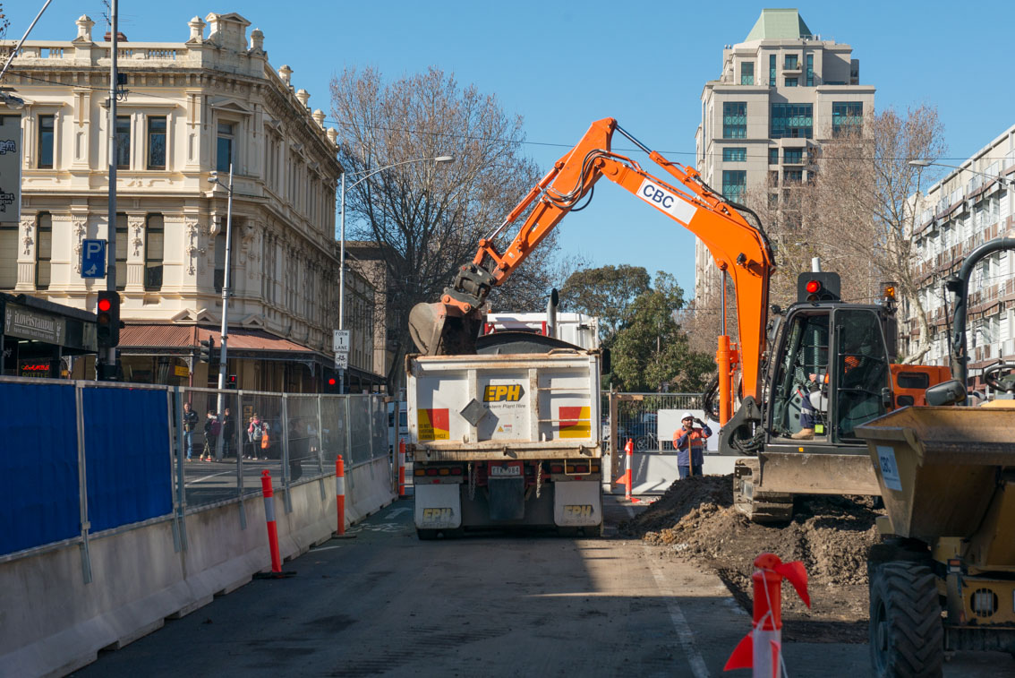 Excavator works at Queensberry and Lygon streets in July 2017.