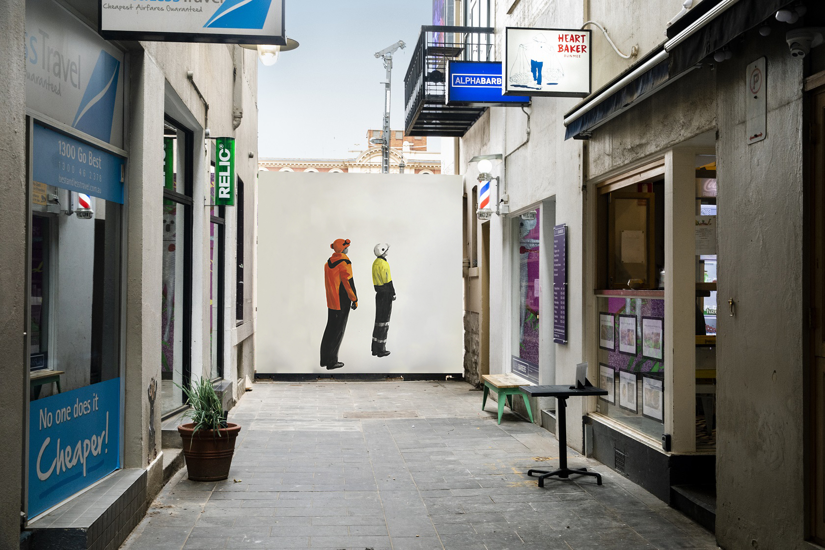 An artwork of two people standing looking upwards, on a temporary wall at the end of a laneway