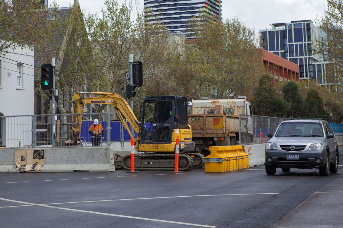 Works at the intersection of Queensberry and Drummond streets to make roads wider for Grattan Street closure detours.