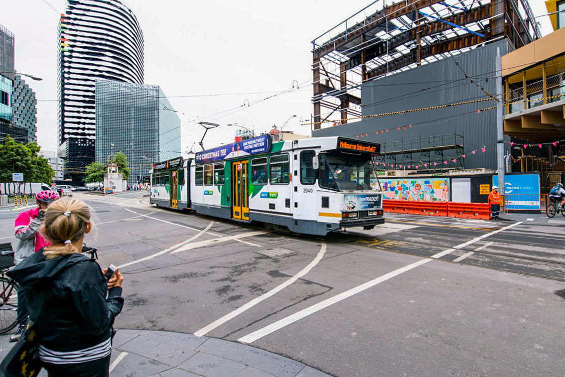 A tram passing the Franklin Street acoustic shed on Swanston Street.