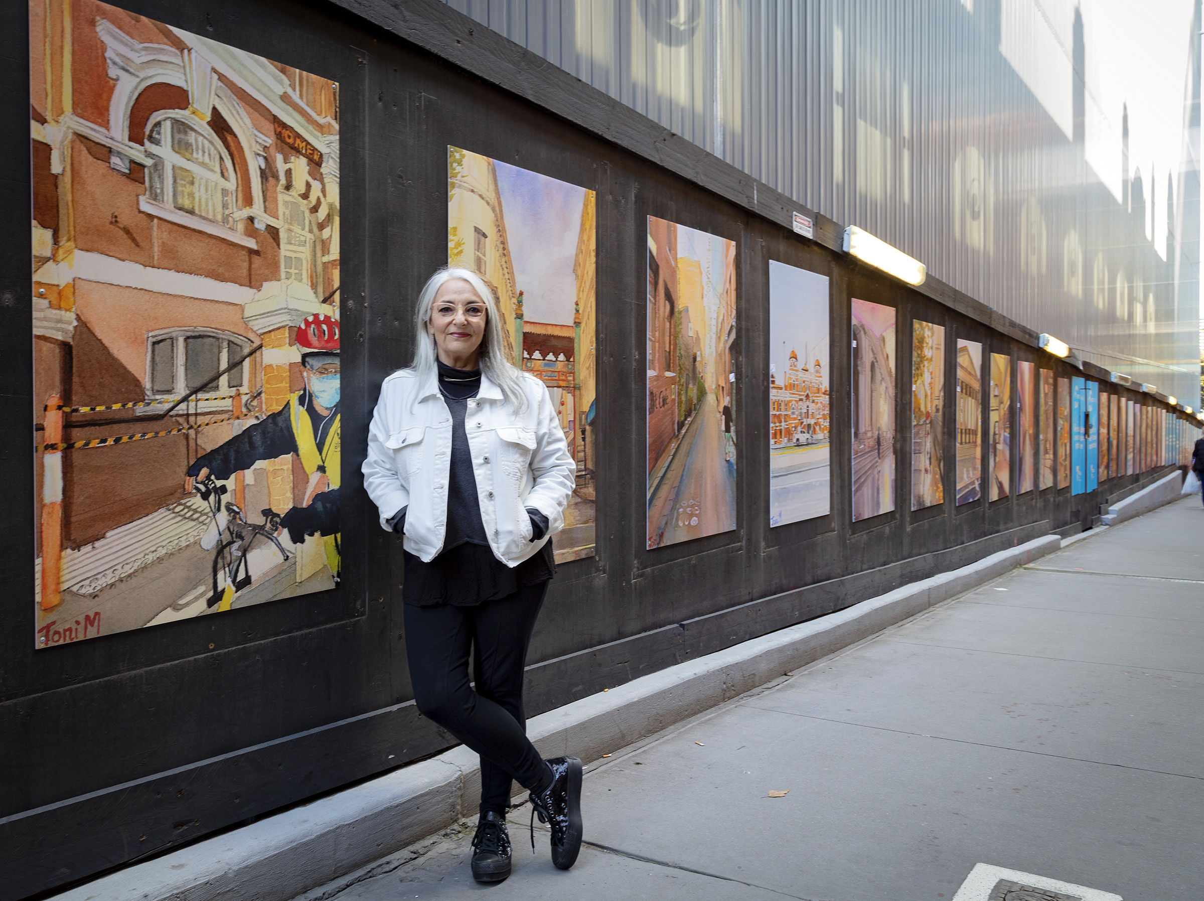 Artist Toni Major with her artwork at the State Library Station construction site.