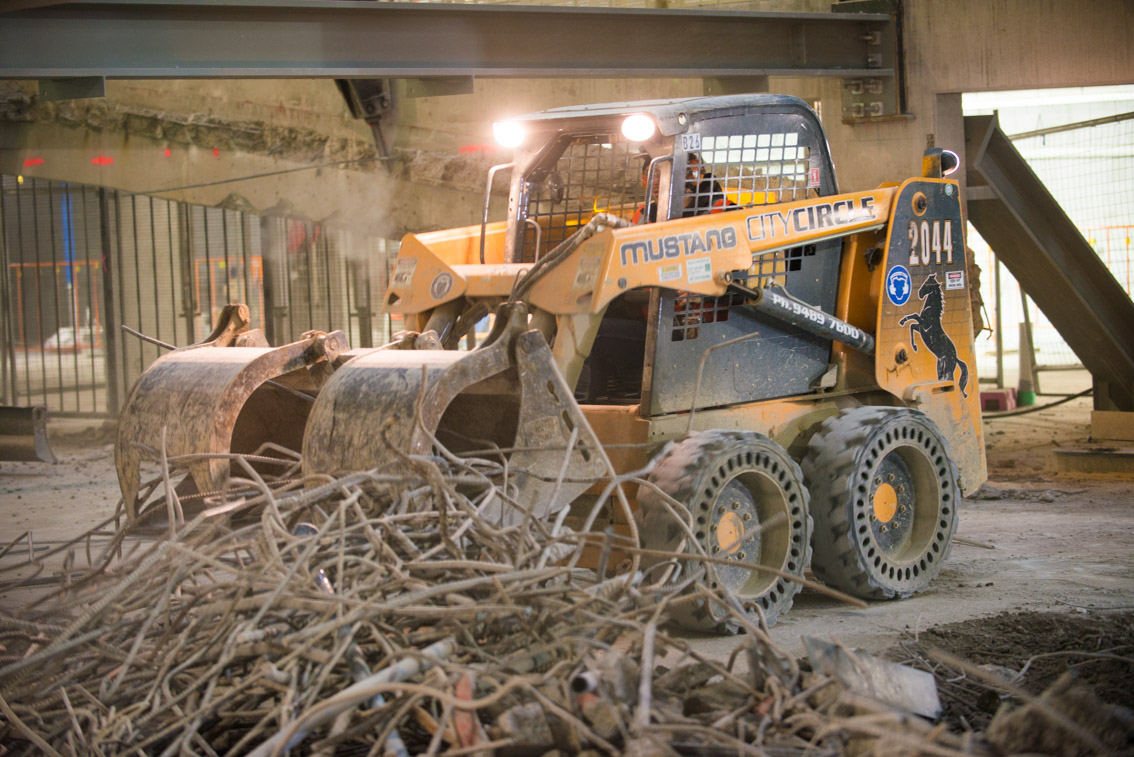 A 2044 Skid Steer being used to move debris from demolition works at City Square.