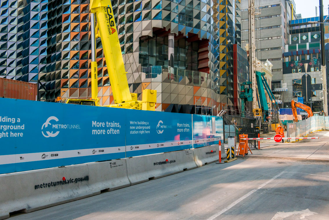 Metro Tunnel signage and piling works in the background at the A'Beckett Street site.