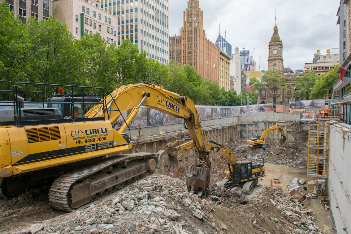 Three excavators at the City Square work site during demolition clean up.