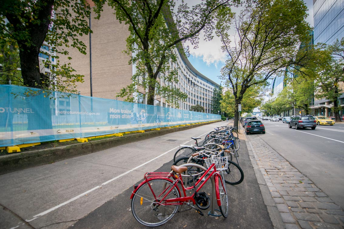 Bikes in front of University of Melbourne and Metro Tunnel work site on Grattan Street.