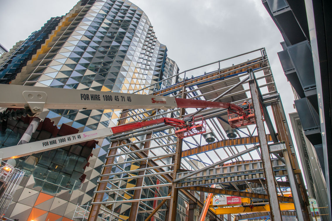 Two elevating work platforms at the A'Beckett Street acoustic shed while under construction.