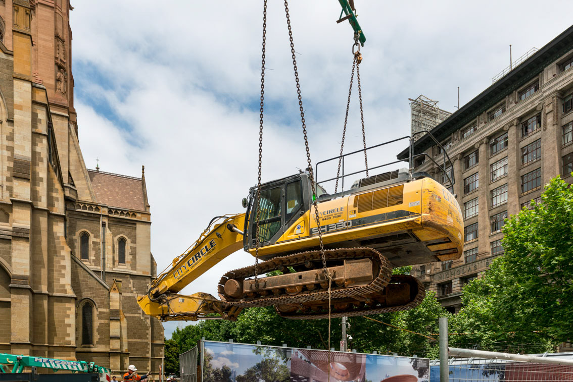 SH 330 excavator being lifted into City Square.