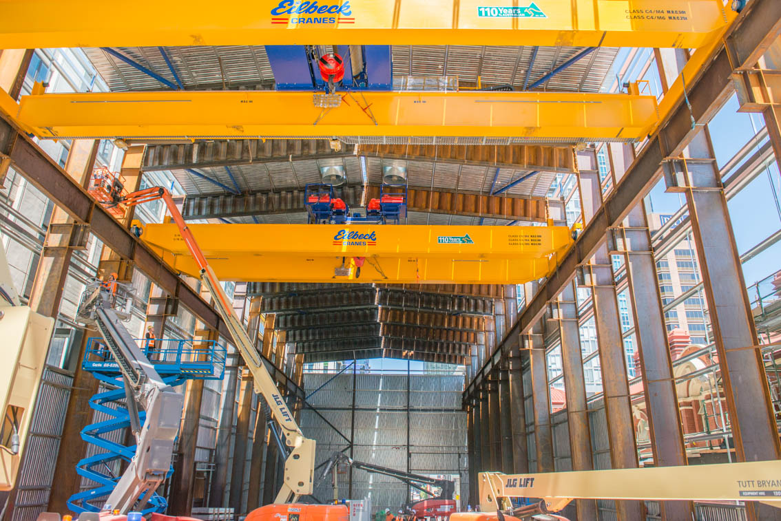 Three yellow gantry cranes inside the Franklin Street acoustic shed.