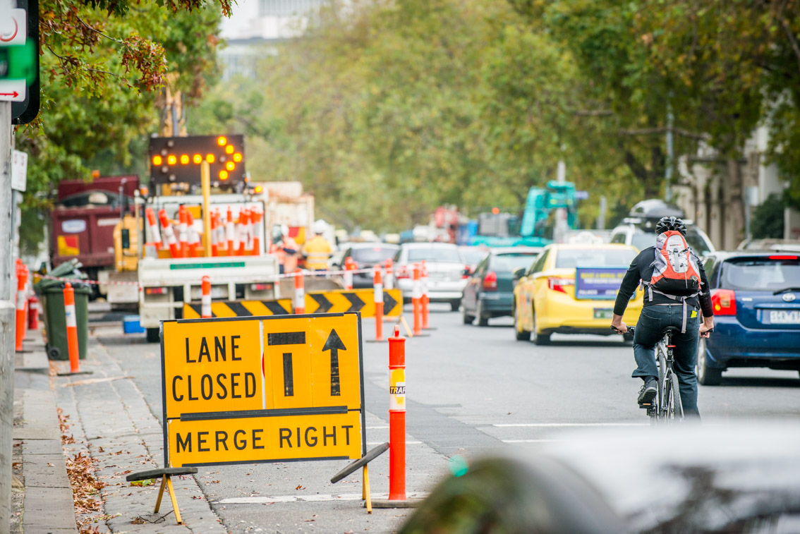 Traffic management signs during lane closures on St Kilda Road.