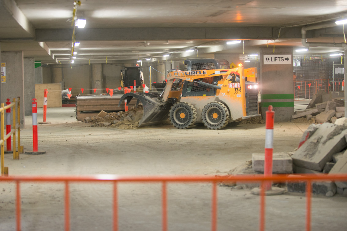 A 1650R Skid Steer moving debris inside the City Square car park.