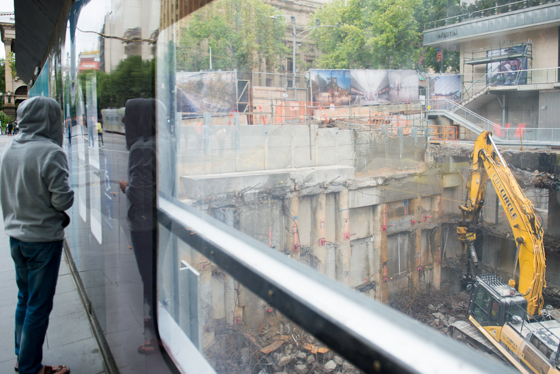 Swanston Street viewing windows of City Square works.