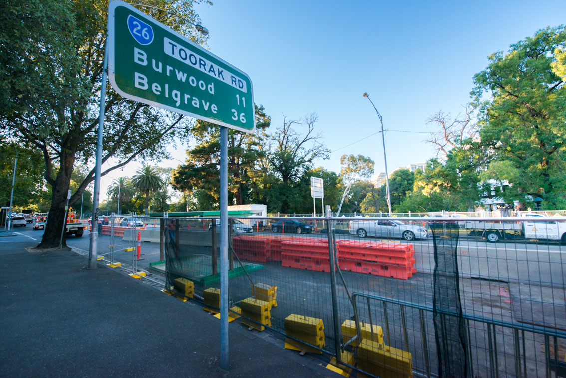 Metro Tunnel fencing and lane closures on St Kilda Road nearby Toorak Road intersection.