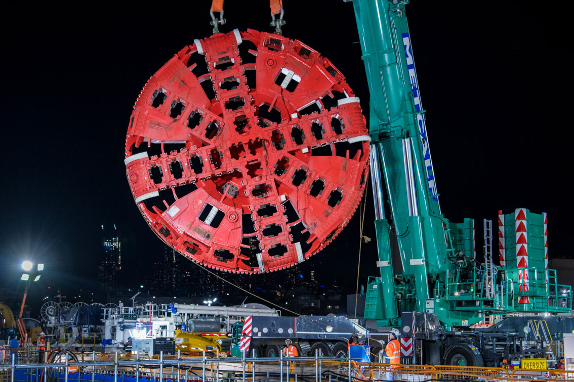 Joan the Tunnel Boring Machine's cutterhead lowered ahead of launch